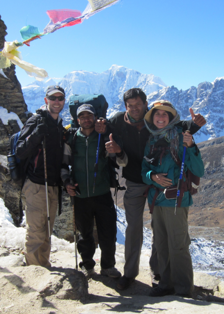 Group of trekkers at high mountain pass, happy to be there