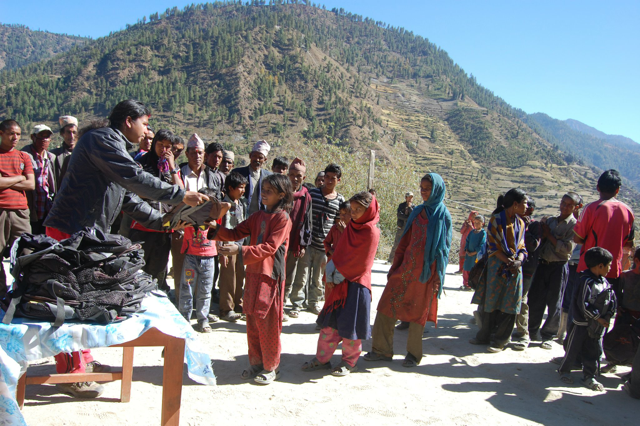Rajan donating bags to village children in village of Mugu, Western Nepal