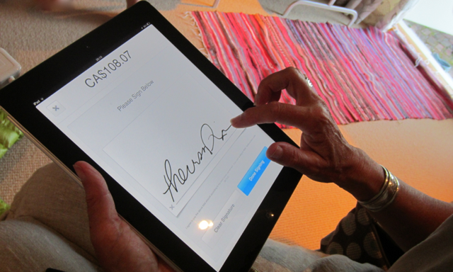 Signing for a credit card purchase using iPad touchscreen