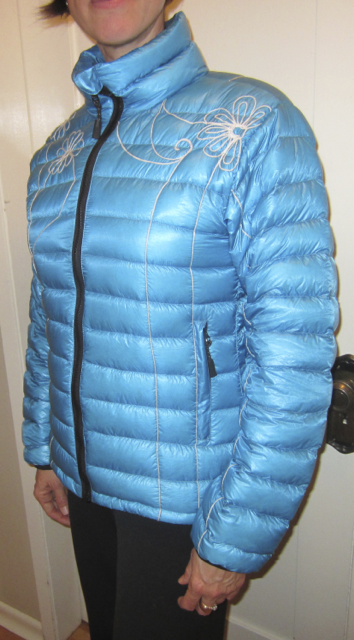 Woman wearing turquoise embroidered slim down jacket