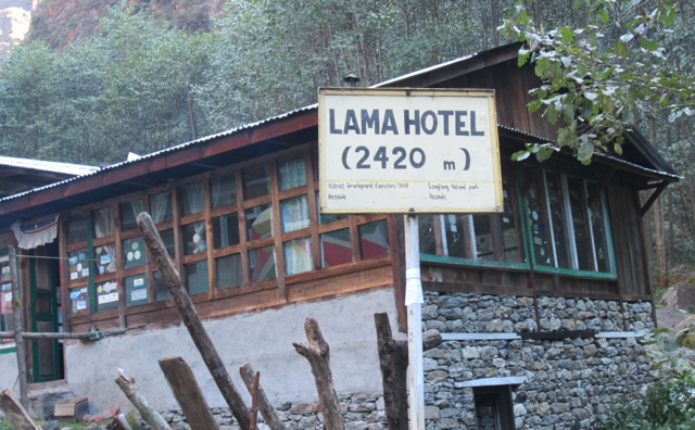 Typical Langtang valley lodge with trail marker