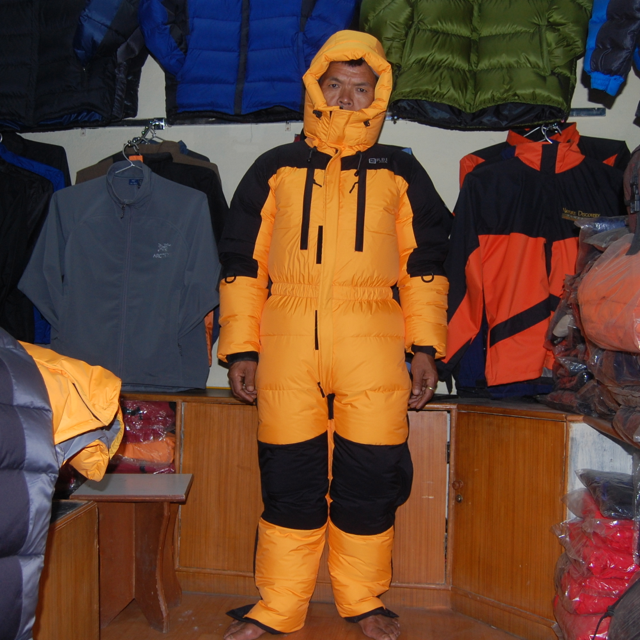 A man wearing one of Rajan's super-warm down mountaineering suits.