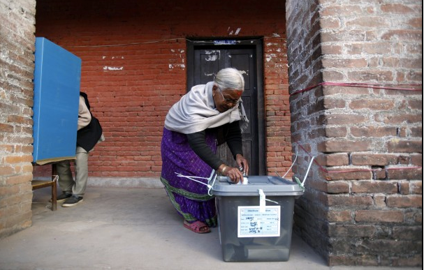 Nepali woman casting her ballot in yesterday's election (Photo credit: AP Photo/Niranjan Shrestha)