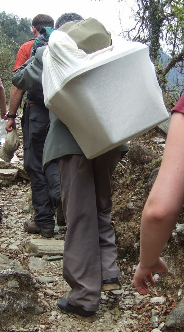 A porter carries a ballot box to a remote village. (Photo credit: danbeckytravels.blogspot.ca)