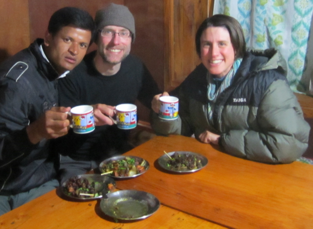 Kamal, Len and Liz raising a toast with buffalo snacks on plates in front
