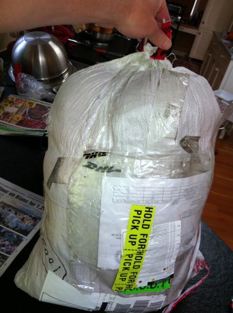 Lumpy rice bag covered in customs stickers
