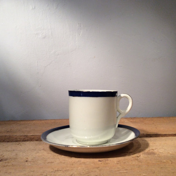 Vintage Ceramic Cup and Saucer with Blue Edge