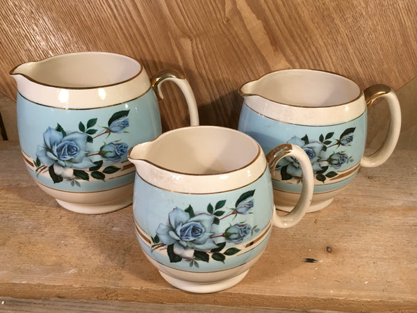 set of three 1950's milk jugs