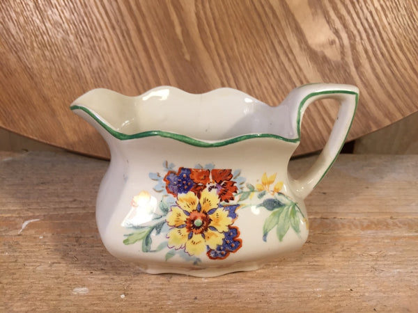 Vintage multi flower milk jar