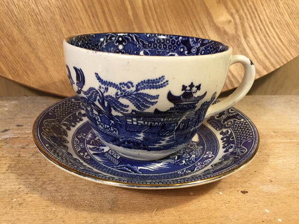 Blue and white cup and saucer set
