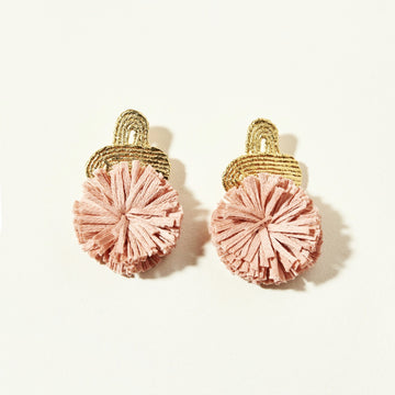 The Hannah Tassels in Peony Pink Habu Cotton. Toped with a textured, 14k gold plated earring.