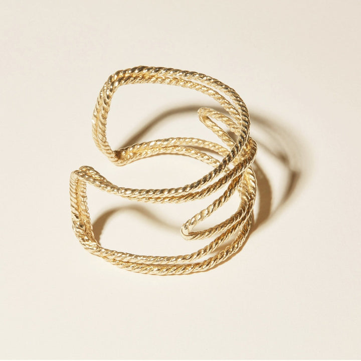 The Windward Cuff is rope-like bracelet that wraps around the wrist with a wide woven profile