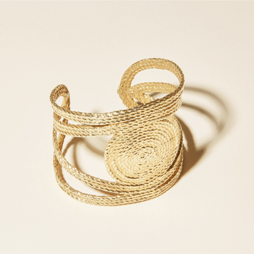 The Sol cuff Bracelet has symmetrical design with a center spiral.