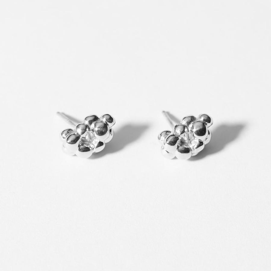 The Cluster Stud Earrings in sterling silver look like a tiny pile of pebbles. Very organic in shape and dimensionally sit on the ear lobe.