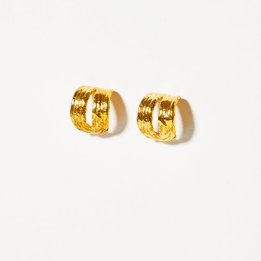 Soft, split ovals are characterized by the textural earrings. Composed in cotton fiber, the final earrings look like the material they were cast from.