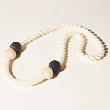 The Port Necklaces combines 3 elements: soft cotton cord, natural and indigo dyed beads, and compressed, felted wool.