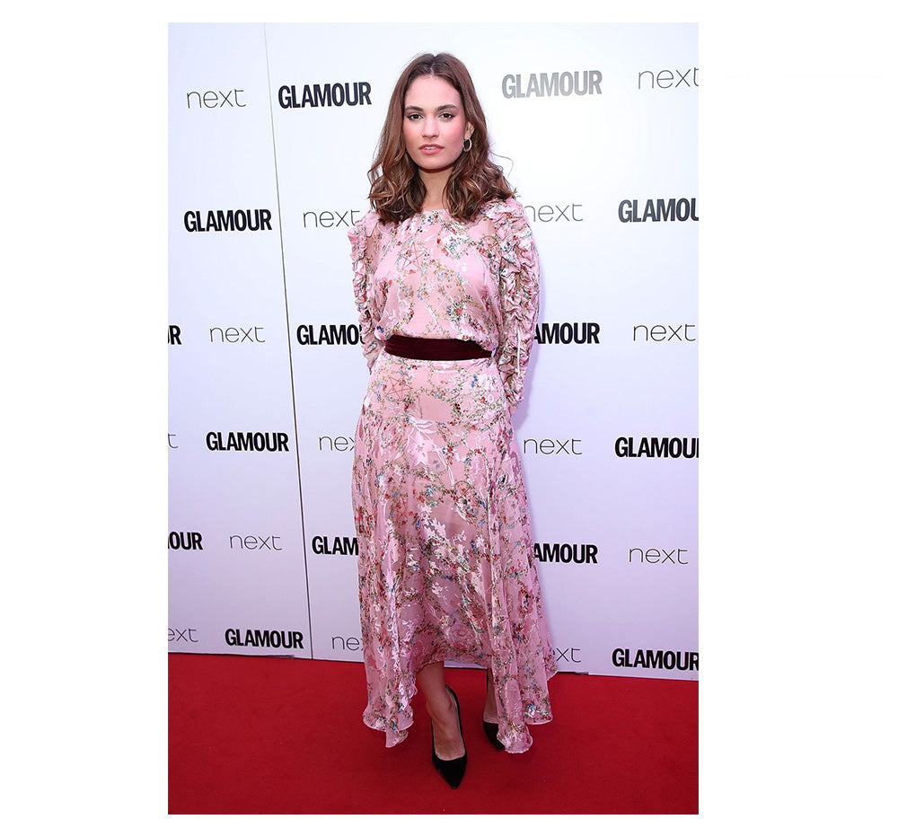 Lily James wearing luxury Preen By Thornton Bregazzi pink floral print full length dress