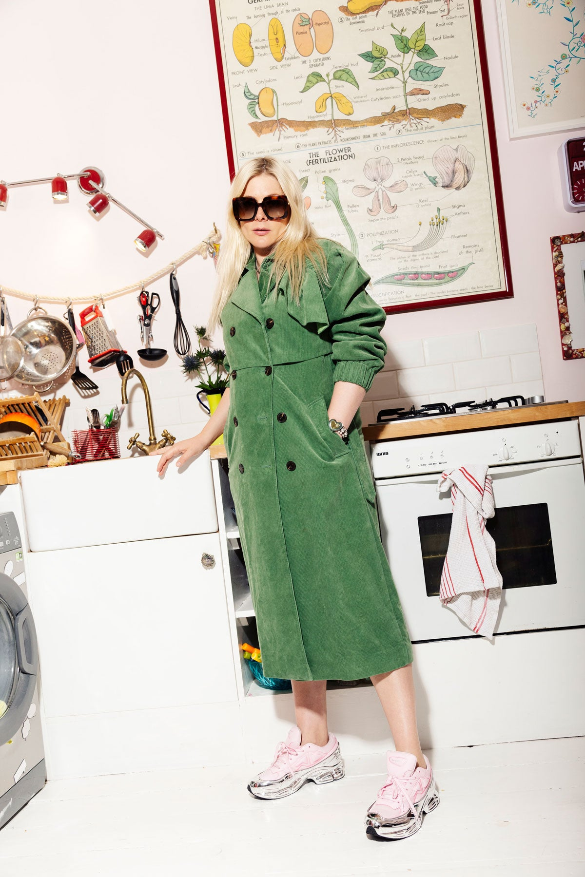 Bella Howard in preen line wearing a green trench coat from resort 19