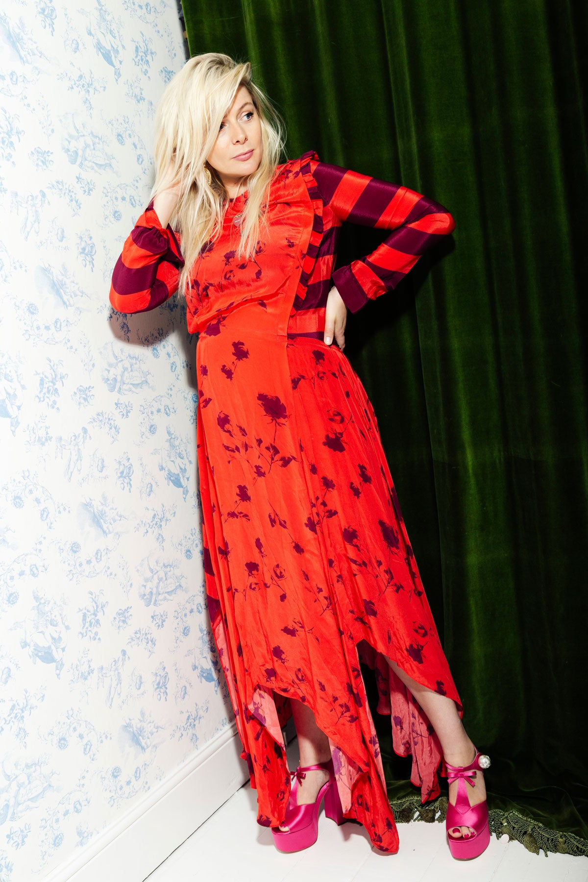 Bella Howard in preen line wearing a red dress from resort 19