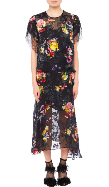 PREEN BY THORNTON BREGAZZI LUXURY DESIGNER SILK SATIN DEVORE DRESS WITH DROP WAIST AND ASYMMETRIC HEMLINE IN BLACK FLORAL PRINT. WITH BLACK LACE TRIMMED SHORT SLEEVES