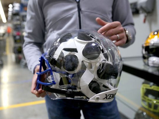 Detroit Free Press: Dan Gilbert-backed football helmet maker is butting heads with big industry players