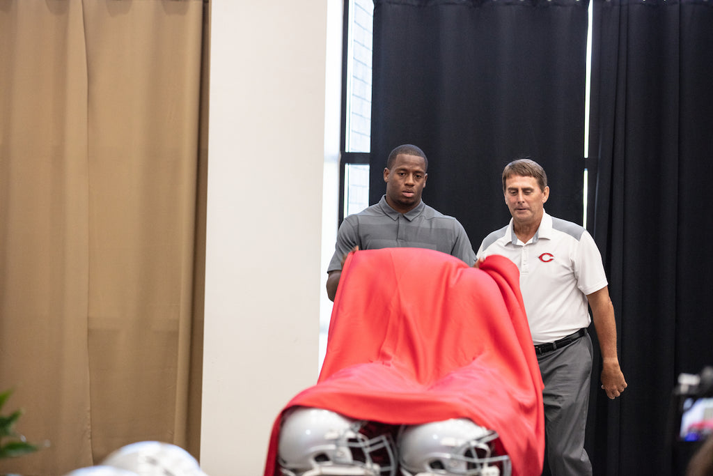 Nick Chubb revealing Epic+ Helmets to Cedartown High School