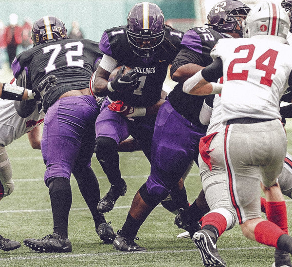 Everman Football Running Back jumping through crowd of players