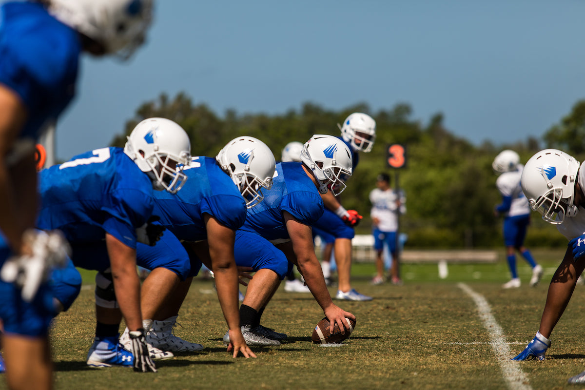 IMG Football Players lining up on the football