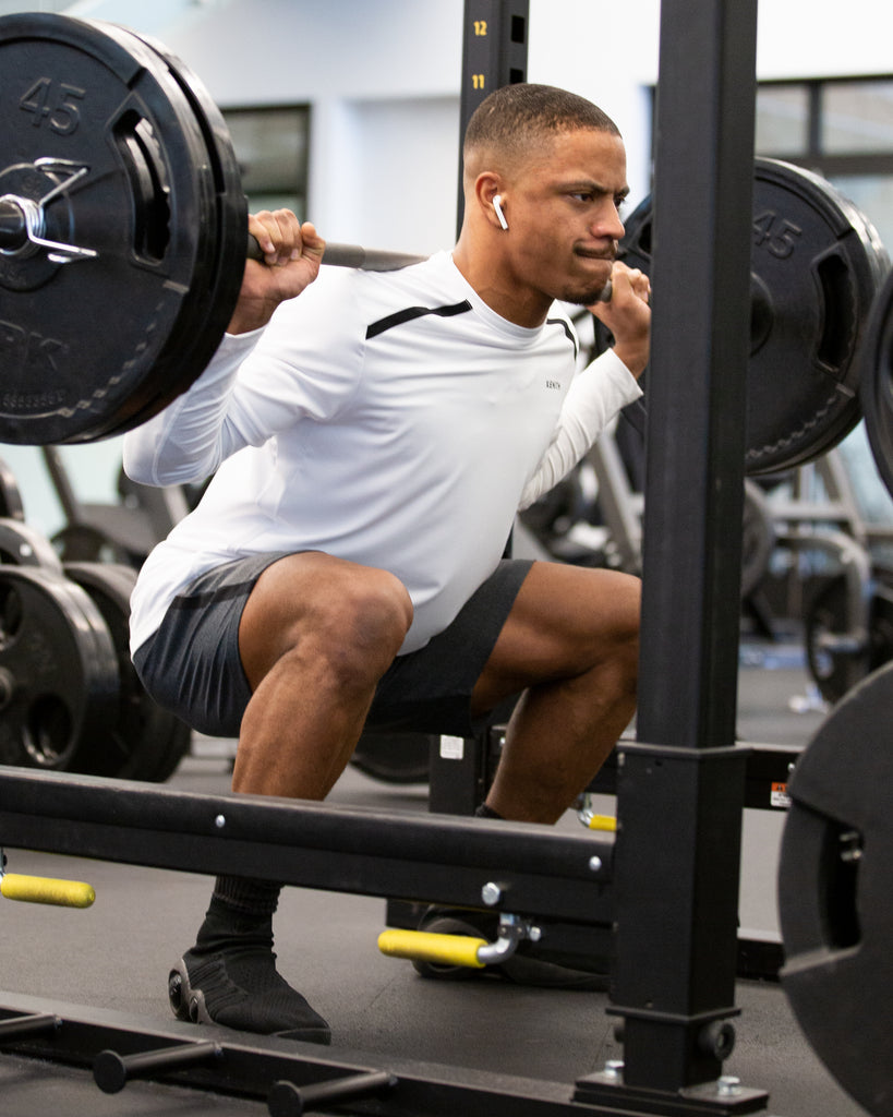 Athlete performing a barbell back squat