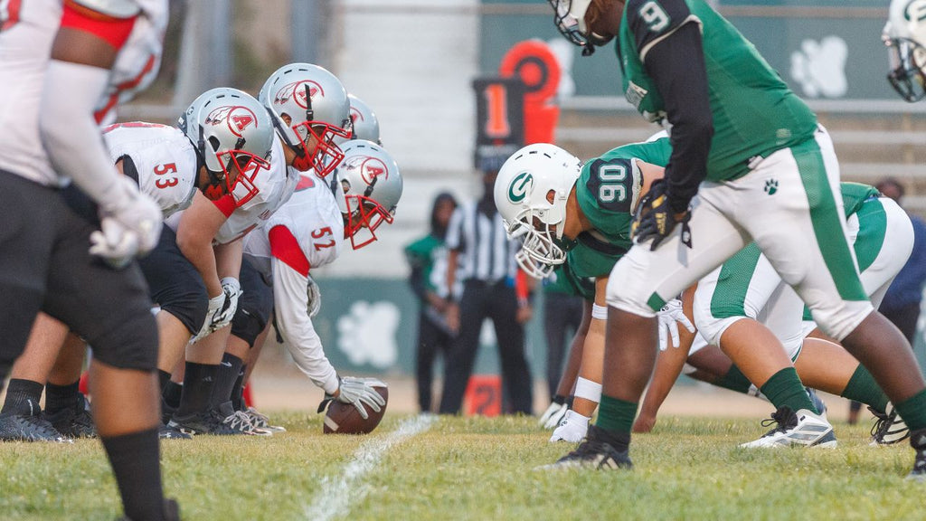 Players from Gardena and Compton Centennial High Schools face off on the field during their game this season.