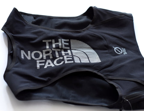 The back of The North Face trail running vest pack, features The North Face logo