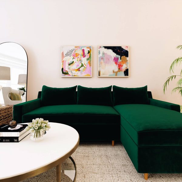 Abstract wall art pair over a green sofa