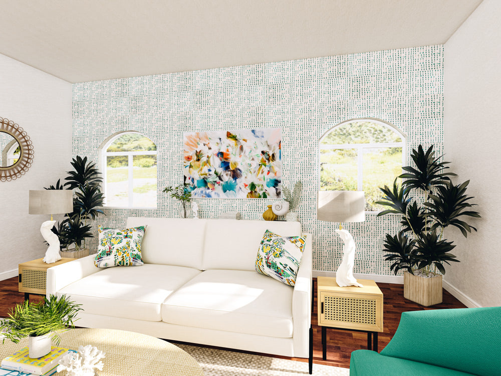 Colorful abstract wall art featuring blue, greens, and orange in bright tropical coastal living room via Parima Studio.