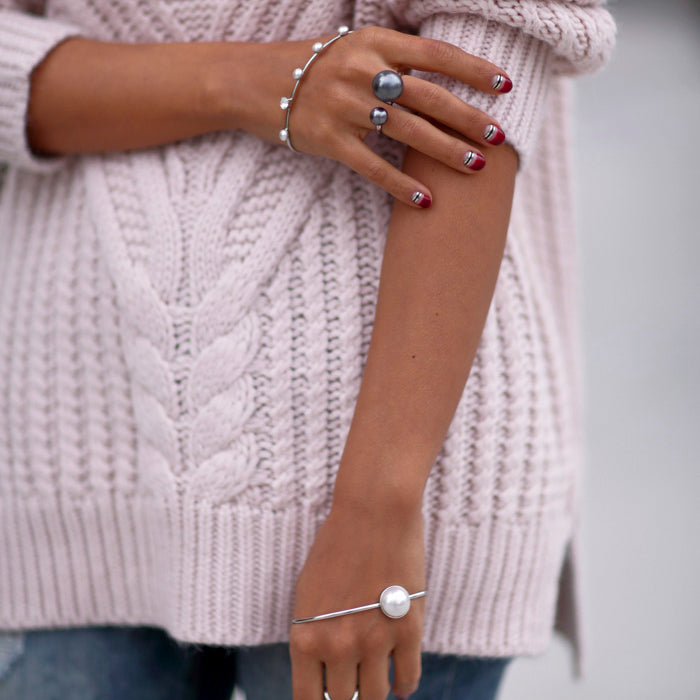 Annabelle Fleur of The Viva Luxury Blog wears Sarina Suriano Sparkling Caelum and Lustrous Oculous palm cuff and Sagittarius Astris pearl ring