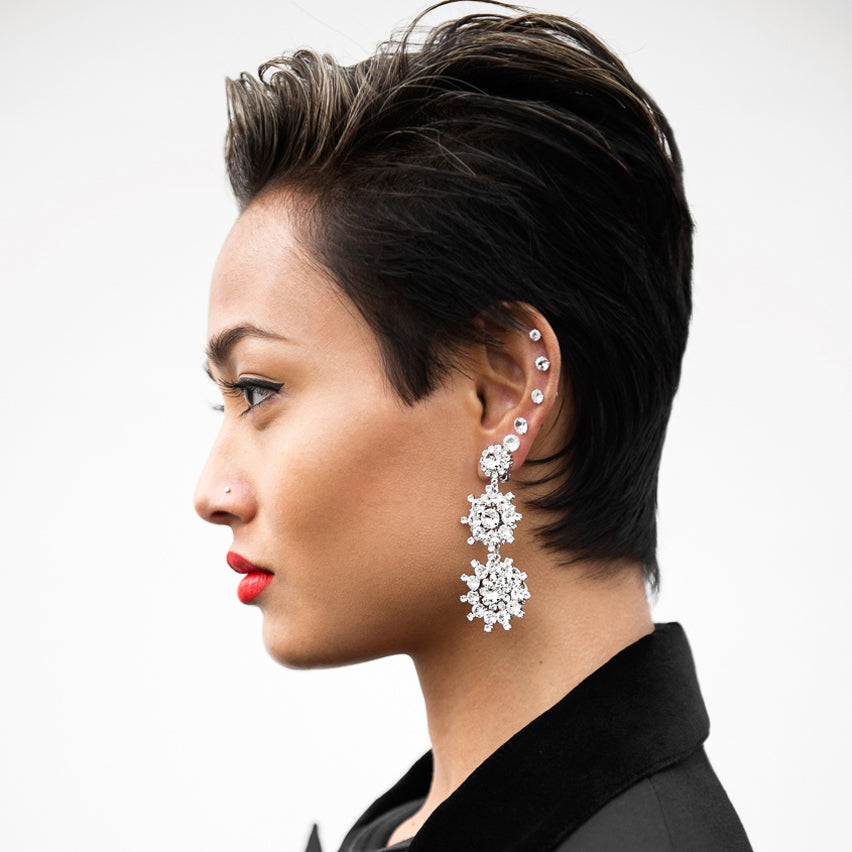 Micah Gianneli wears Sarina Suriano Lumina crystal drop earrings
