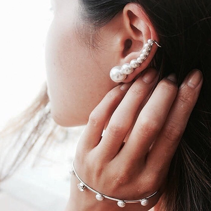 Emily Highfield of The StyleBk blog wears Sarina Suriano Sparkling Caelum Palm cuff and Luna Kingdom pearl ear cuff and stud