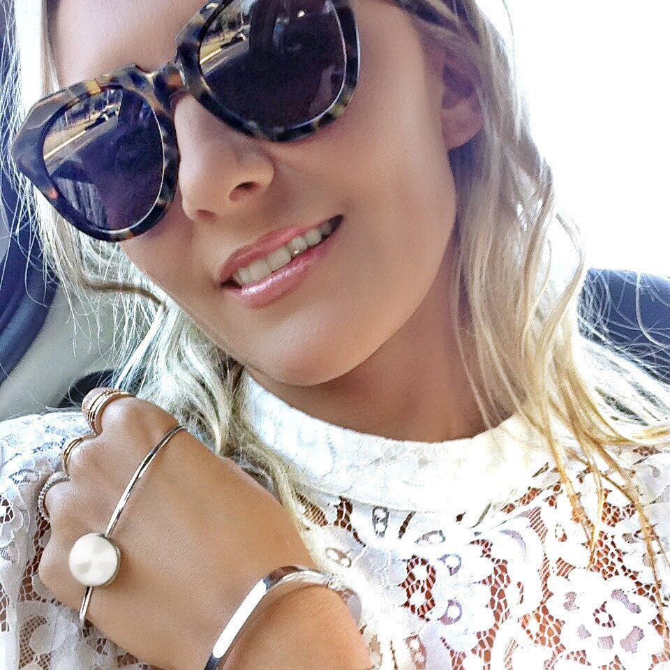 Olivia Wagner Global Swarovski PR wears Sarina Suriano Lustrous Oculous pearl palm cuff