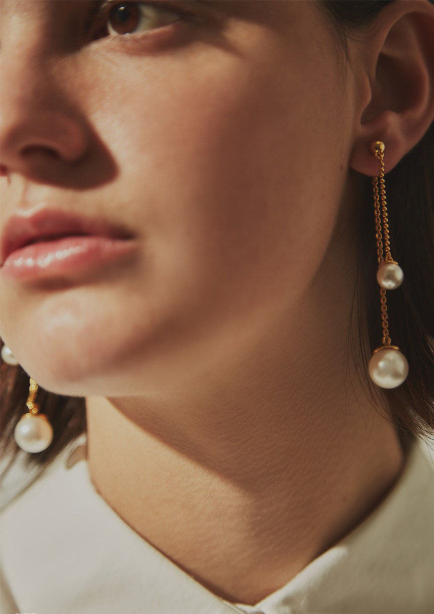 Russh Australia fashion shoot Still Sounds - featuring Sarina Suriano Pendulus earrings with Swarovski pearls from the Sphera collection.
