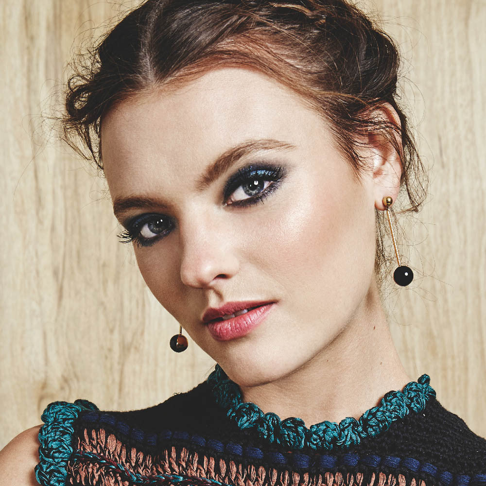 Model Montana Cox wears Sarina Suriano Luna earrings in black onyx and 18K gold plating from the Sphera collection
