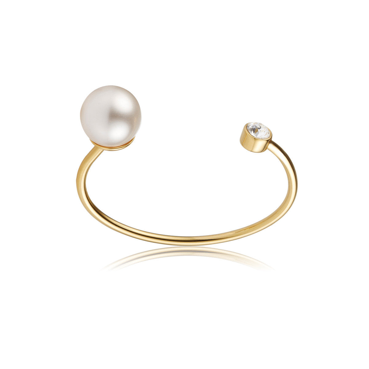 Solid brass, 18K gold plated Crystal Orbis bangle topped with Swarovski® crystal and a faux pearl – front