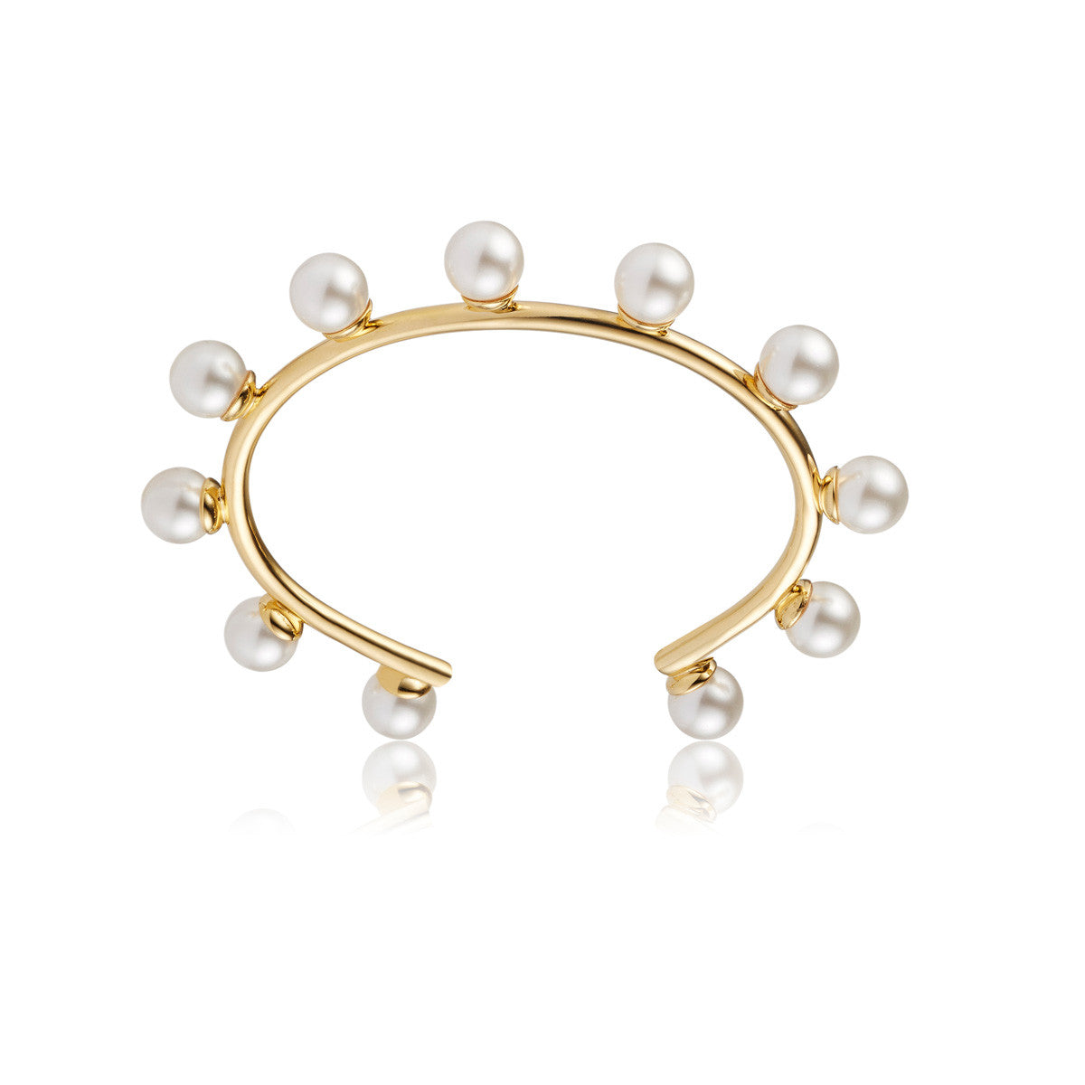Solid brass, 18K gold plated Luceat bangle topped with 11 lustrous Swarovski® pearls – front