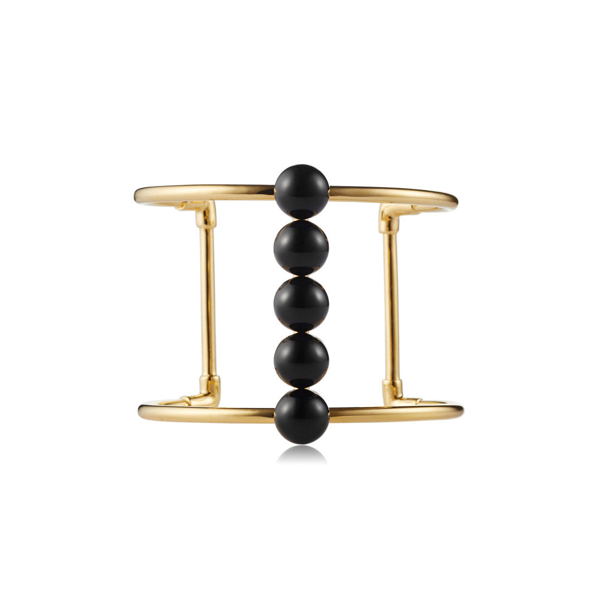 Solid brass, 18K gold plated Moonraker cuff bangle features a bold line of natural black onyx spheres along the centre – front
