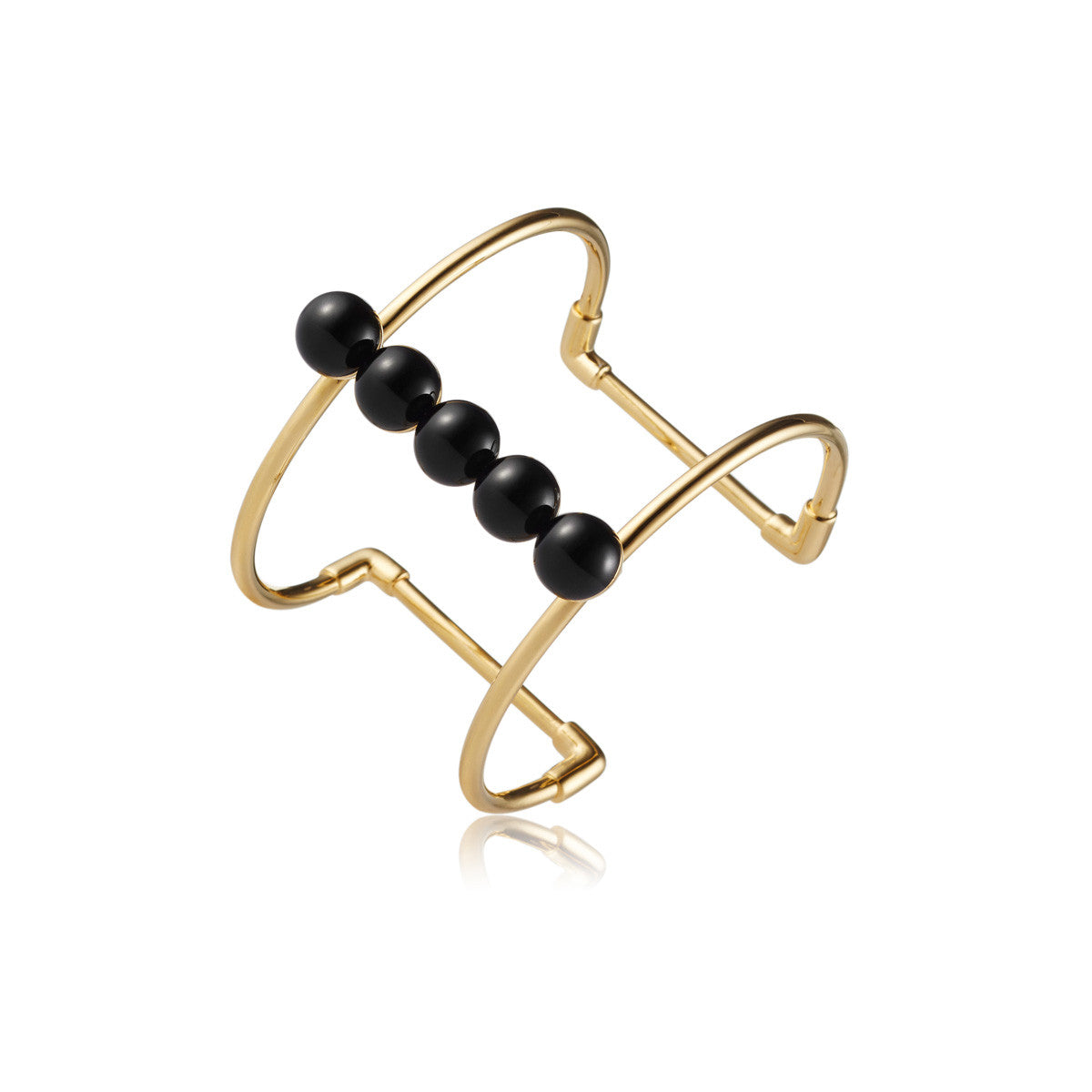 Solid brass, 18K gold plated Moonraker cuff bangle features a bold line of natural black onyx spheres along the centre - side