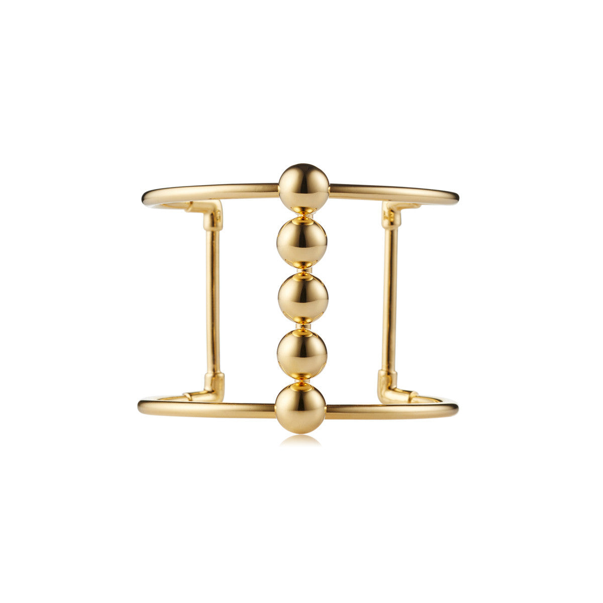 Solid brass, 18K gold plated Moonraker cuff bangle features a bold line of gleaming metal spheres along the centre – front