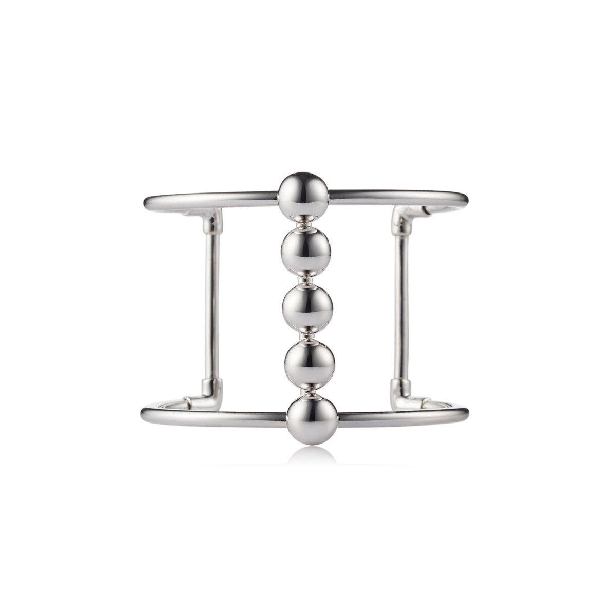 Solid brass, rhodium plated Moonraker cuff bangle features a bold line of gleaming metal spheres along the centre – front