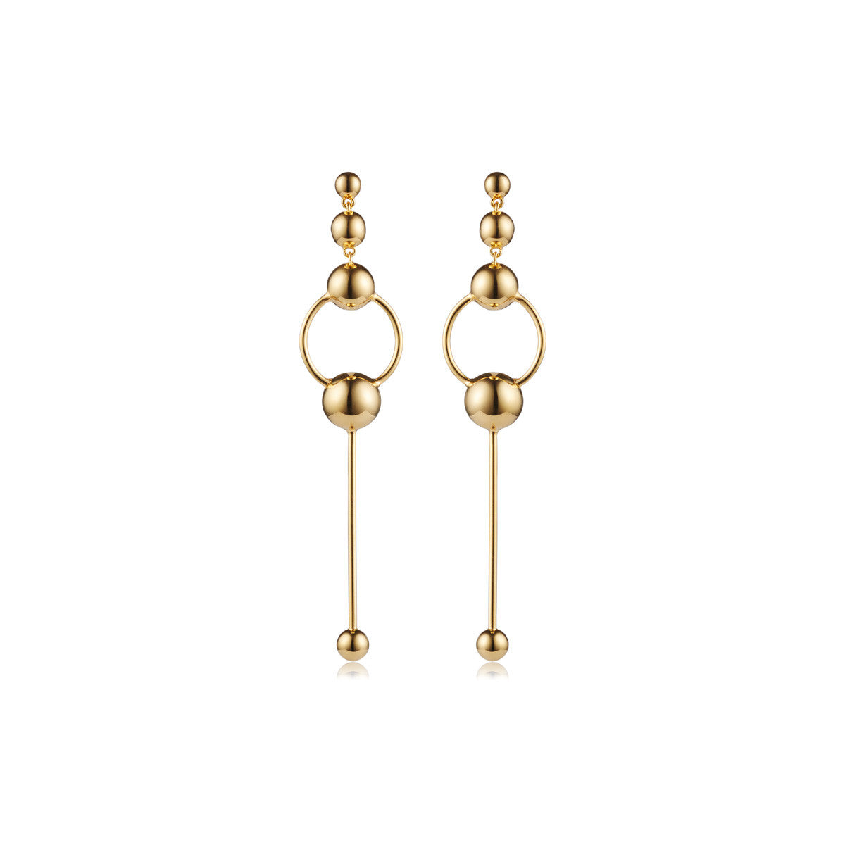 Solid brass, 18K gold plated Orbita earrings with graduating spheres will take you from day to night - front