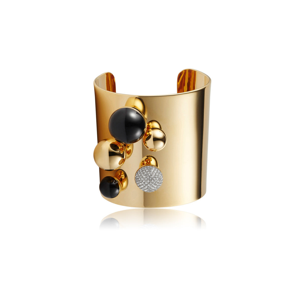 Solid brass, 18K gold plated Stellatus cuff bangle is topped with a cluster of spheres in Swarovski® crystal pavè detailing and natural black onyx - front