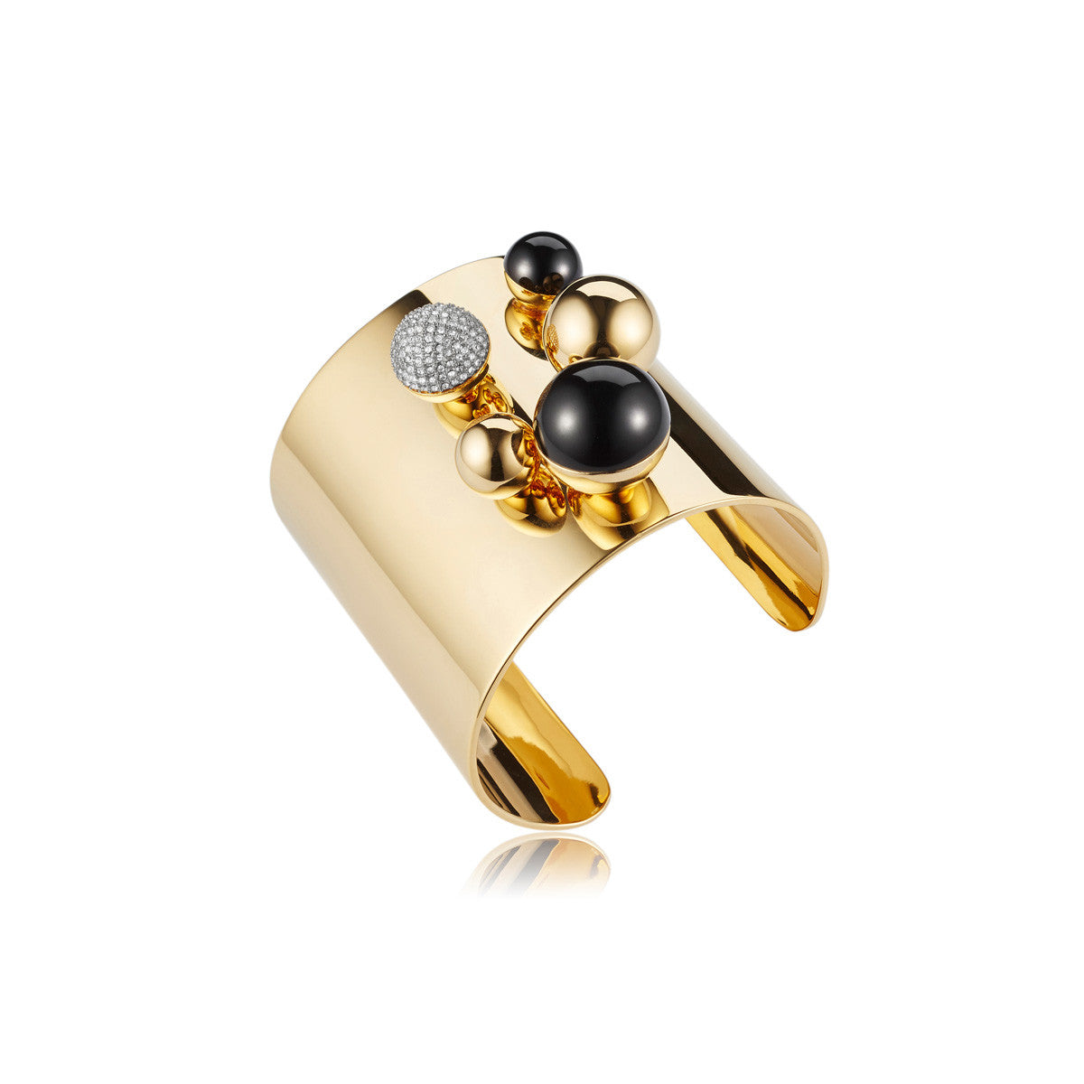 Solid brass, 18K gold plated Stellatus cuff bangle is topped with a cluster of spheres in Swarovski® crystal pavè detailing and natural black onyx - side