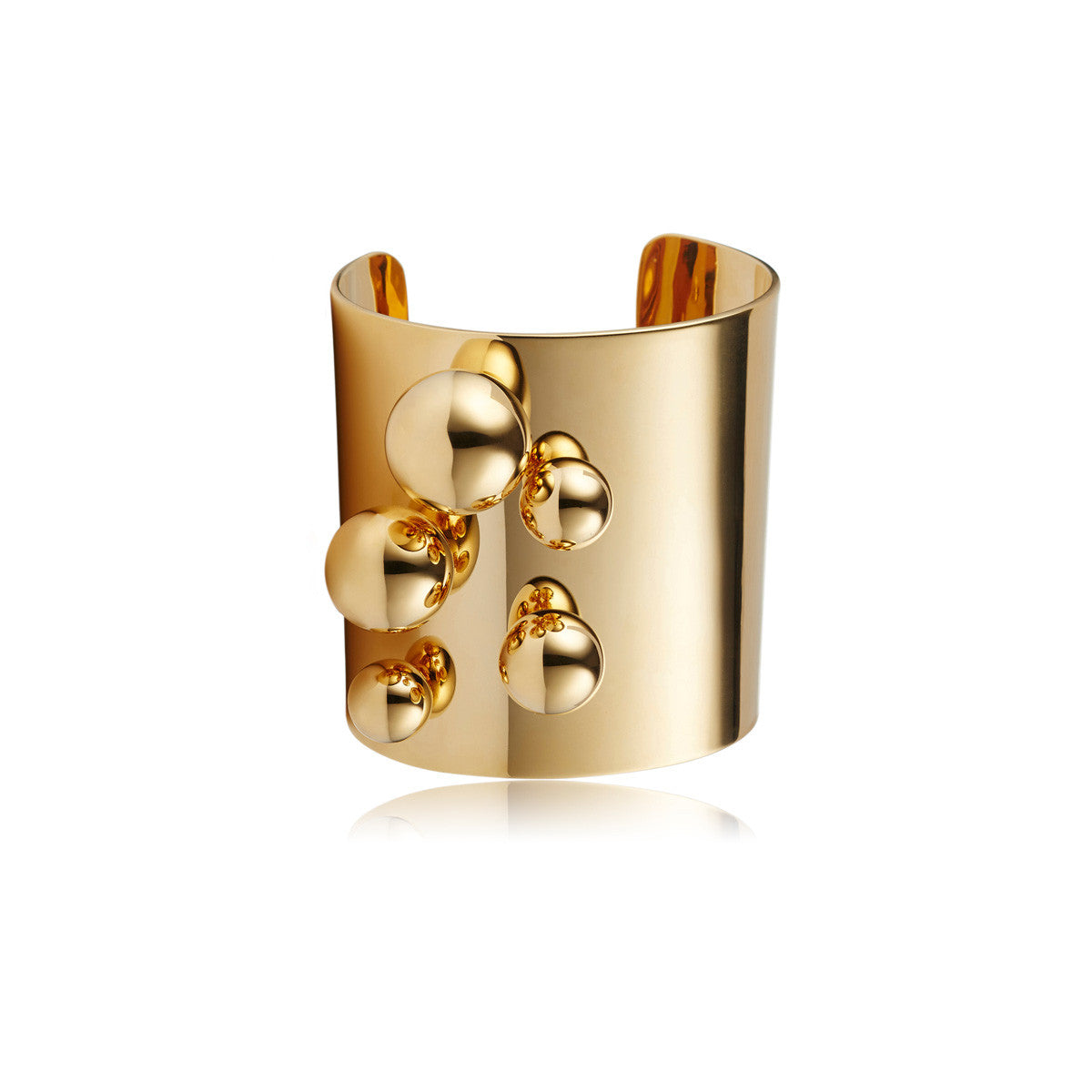 Solid brass, 18K gold plated Stellatus cuff bangle is adorned with a cluster of spheres – front