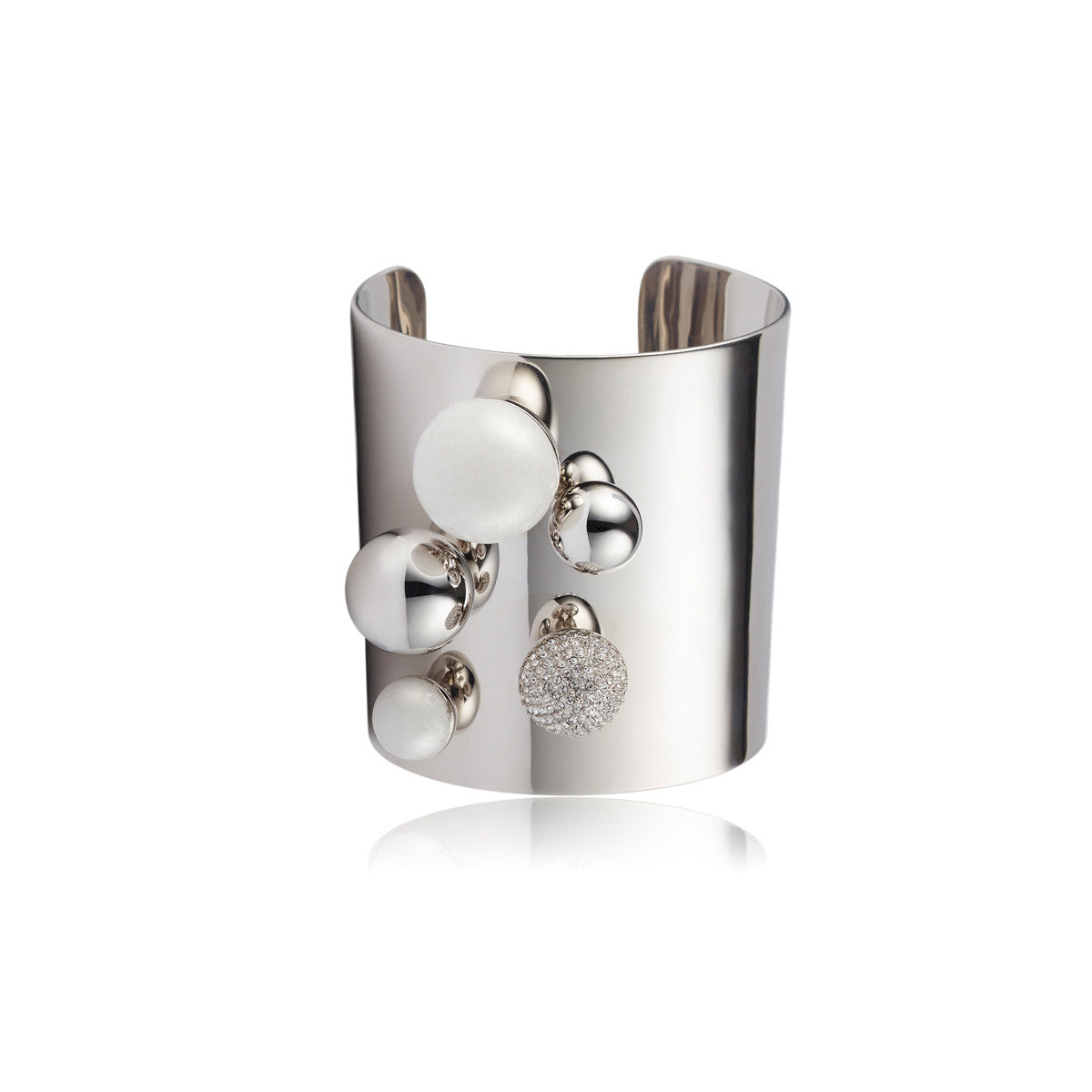 Solid brass, rhodium plated Stellatus cuff bangle is topped with a cluster of spheres in Swarovski® crystal pavè detailing and natural white agate – front